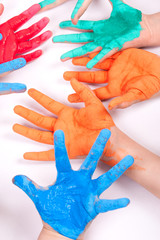 colorful hands against white background