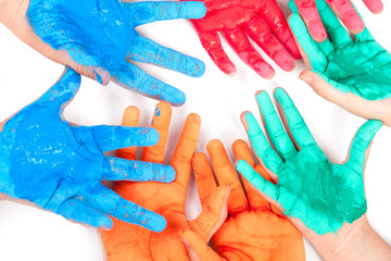 colorful hands against white