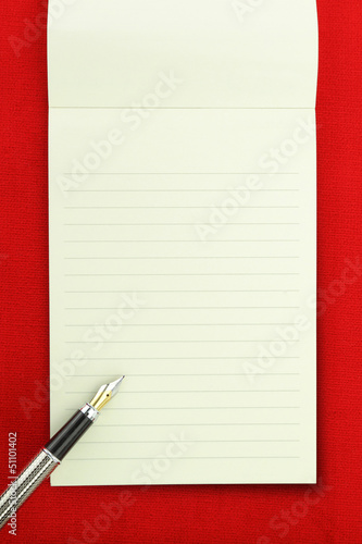 Blank notebook on red background