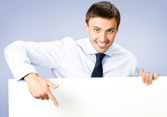 Business man showing blank signboard, on violet