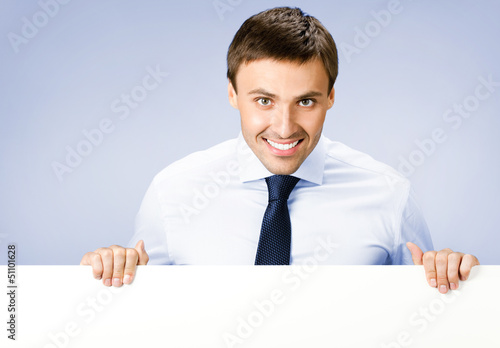 Business man showing blank signboard, on violet
