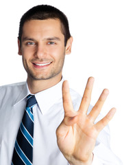 Businessman showing four fingers, isolated