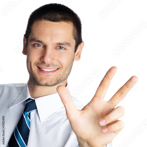 Businessman showing three fingers, isolated