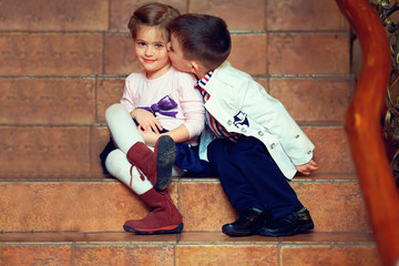 little gentleman kisses girl