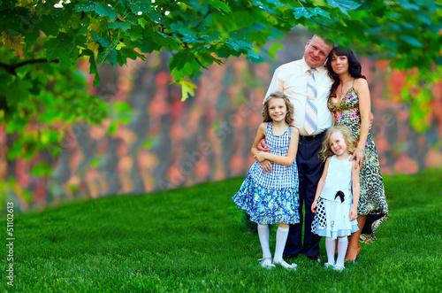 beautiful family portrait, colorful outdoors