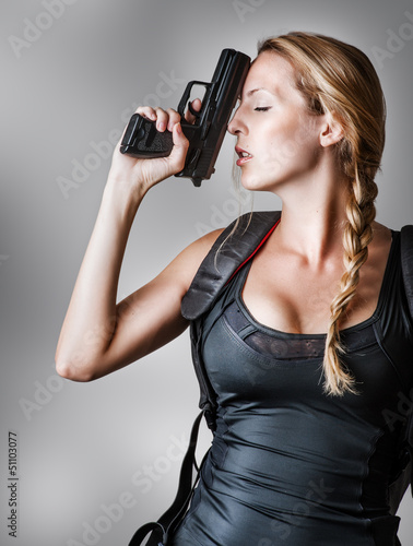 Young sexy blond Woman With Handgun