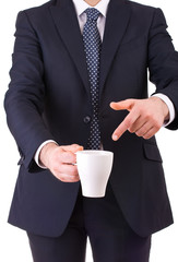 Businessman pointing at his cup of coffee.