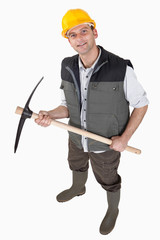 bricklayer holding pickaxe