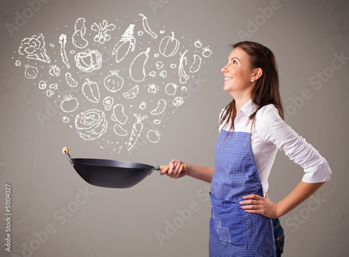 Woman cooking vegetables