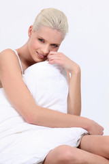 Woman sat covered by duvet