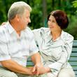Senior happy couple embracing, outdoors