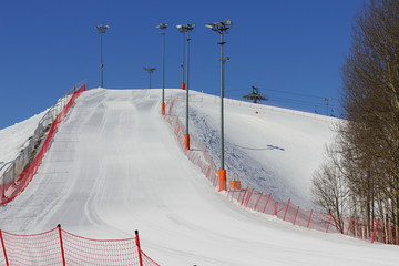 View from the bottom of the ski slope on a sunny day.