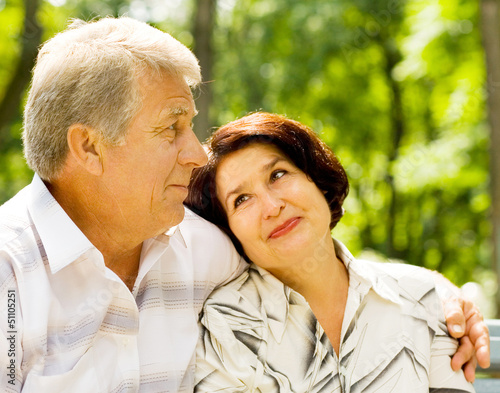 Senior happy couple embracing, outdoors