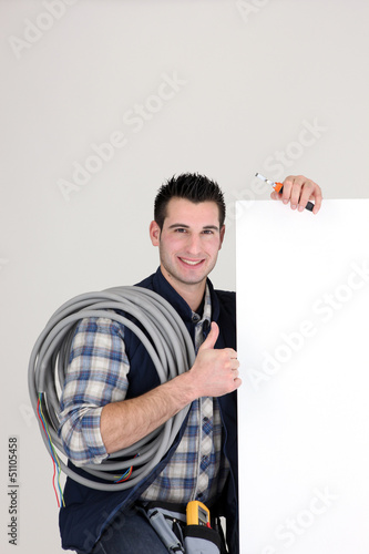 Thumbs up from an electrician with a blank board