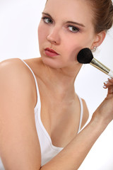 Woman with a blusher brush