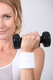 Closeup of woman with dumbbell