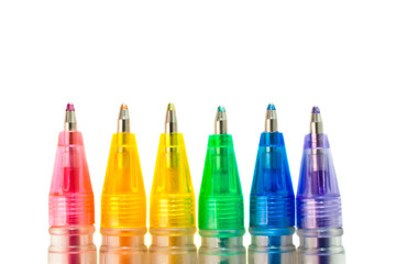 Ballpoint pens of different colors closeup