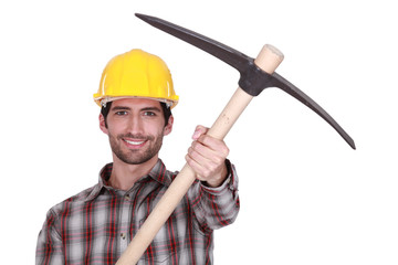 A handyman presenting his pickaxe.