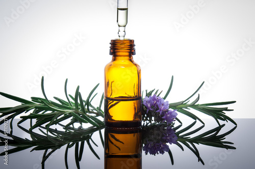 Essential oil with rosemary flowers