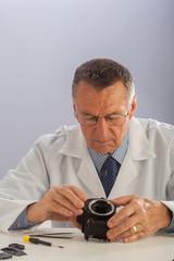 Older Man Repairing Camera