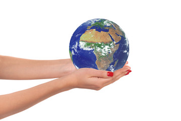 The planet Earth in a woman hands.