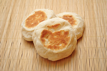 Three English Muffins Ready to be Toasted