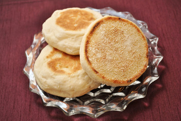 English Muffins Over a Maroon Background