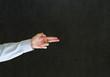 Man pointing fingers like a gun