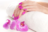 beautiful manicure with pink orchid and towel