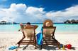 Leinwanddruck Bild - Couple on a beach