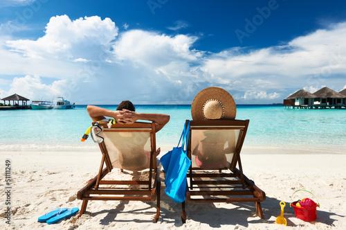 Leinwanddruck Bild Couple on a beach