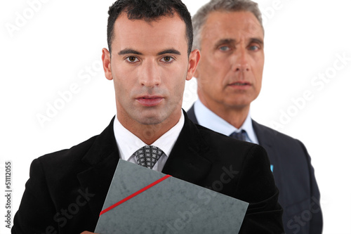 Two businessmen with folder