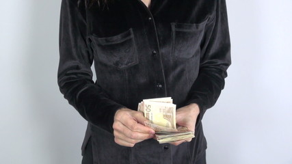 black shirt woman with big pile of banknotes