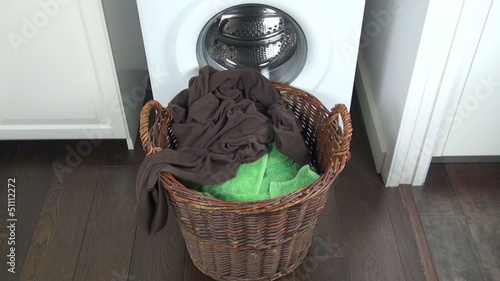 clothes falling in laundry basket