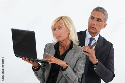 business people analyzing information on their laptop