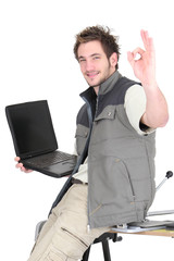 Tile cutter with laptop making OK gesture