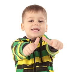 Image of young boy raising hand and showing sign of okay