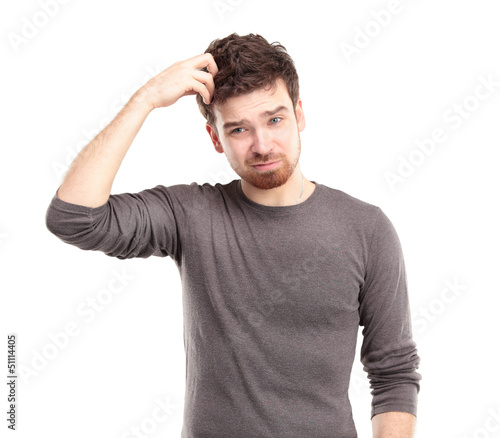 Portrait of Young Man Looking Perplexed