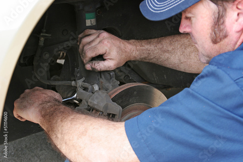 Auto Mechanic Works on Brakes
