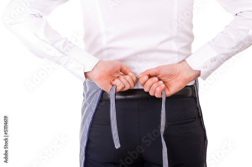 Businessman tying apron strings.