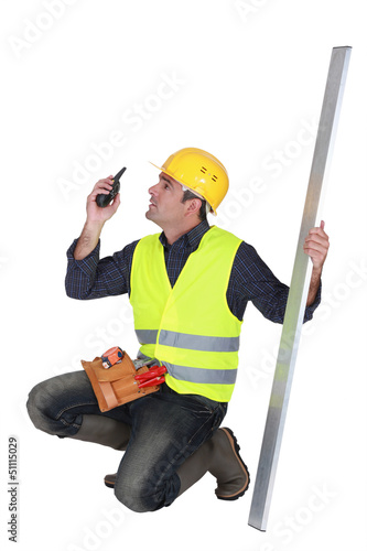 craftsman holding a walkie talkie