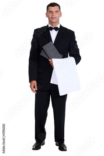 Male waiter stood holding menu