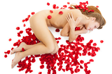 portrait of a nude woman with red rose petals