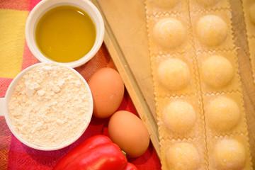 Homemade raviolis with ingredients.