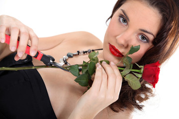 Glam woman with a red rose