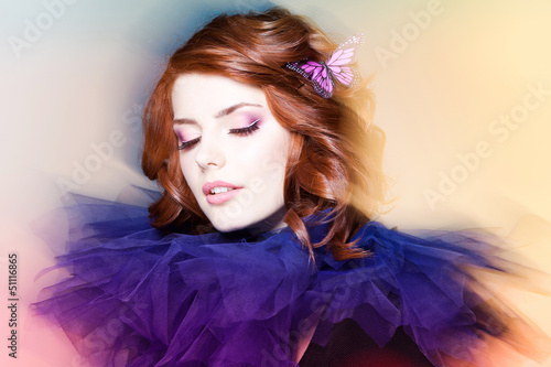 pretty woman with a butterfly in her hair - beauty shot (intenti