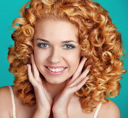 Red Wavy Hair. Healthy Curly Hair. Beautiful happy smiling girl