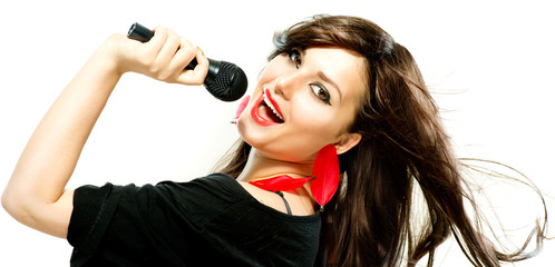 Beautiful Singing Girl. Beauty Woman with Microphone over White
