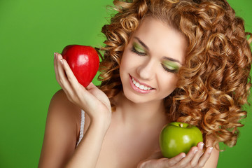 Healthy Curly Hair. Attractive smiling girl portrait on green ba