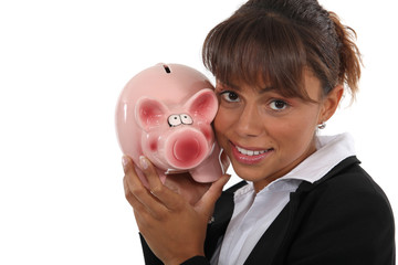 Woman with a piggy bank in hand